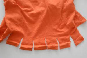 Oranje stof stroken knippen voor flostouw